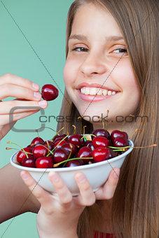 Beautiful teenage girl with cherries