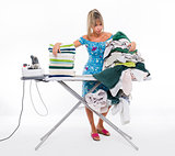 Woman ironing on board many clothing