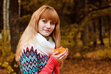 girl with cup of coffee in autumn park