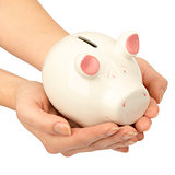 Pigggy bank in womans hands