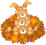 Stuffed teddy bears on set fall leaves