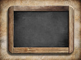 old vintage blackboard with wooden frame on grunge background