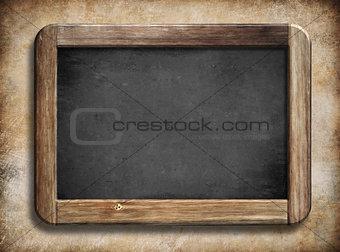 old vintage blackboard with wooden frame on grunge background