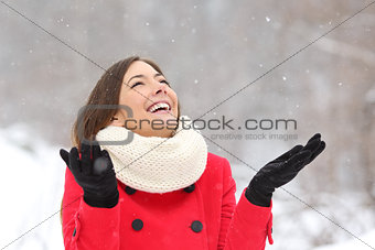 Candid happy girl enjoying snow in winter