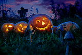 Halloween pumpkins lie on a pumpkin field at night with the eyes of the gears hours.