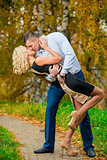 young couple passionately kissing in autumn park