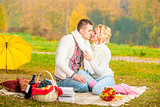 young people spend time on a romantic picnic