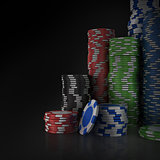 Stacks of poker chips on black background.