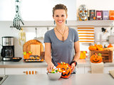 Woman preparing trick or treat candy for Halloween party