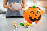 Closeup on halloween bucket full of trick or treat candy