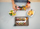 Woman preparing horribly halloween treats for party. Closeup