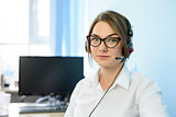 Young Attractive Smiling Customer Support Phone Operator with Headset in Office.