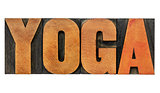 yoga word in wood type
