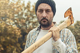 Confident lumberjack with axe