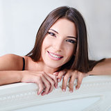 Closeup portrait of beautiful smiling young woman