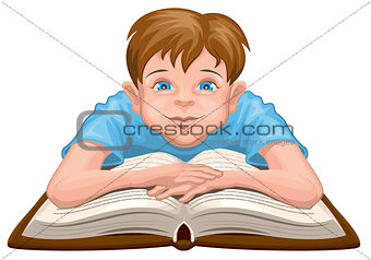 Boy reading book. Child sits in front of an open book
