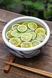 sudachi soba, buckwheat noodles with sliced japanese citrus, japanese food
