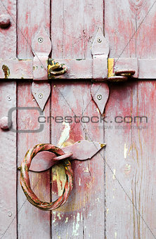 Old wooden door iron handle with lock