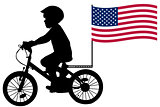 A kid silhouette rides a bicycle with USA flag