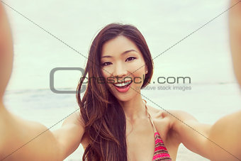 Asian Woman Girl at Beach Taking Selfie Photograph
