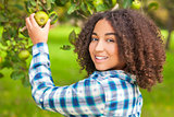 Mixed Race African American Girl Teenager Picking Apple
