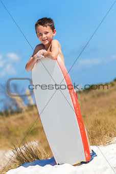 Boy Male Child on Beach With Surfboard