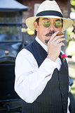 1920s Dressed Man Near Vintage Car Smoking Cigar