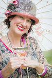 1920s Dressed Girl with Parasol and Glass of Wine Portrait
