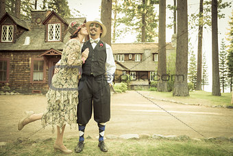1920s Dressed Romantic Couple in Front of Old Cabin