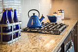 Marble Kitchen Counter and Stove With Cobalt Blue Decor