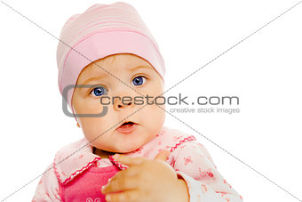 baby girl in a pink dress and hat. Portrait. Studio. Isolated.
