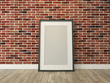 picture frame on the brick wall and wood floor