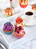 Different delicious cupcakes and coffee cup