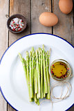Fresh asparagus, olive oil and eggs .