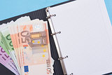 money and blank notepad