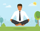 Man is doing yoga and sitting in the lotus position