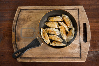 Asian meal fried dumpling in cooking pan