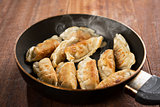 Fried dumpling in cooking pan