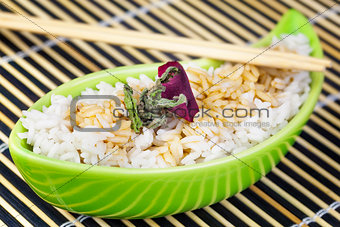 Rice in clay bowl with wooden chopsticks