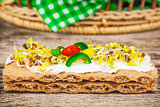 Whole grain crisp bread with sprouts on wooden table
