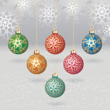 Vector christmas balls with gold design on light background with flakes