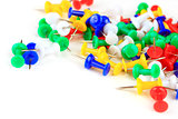 colorful thumbtacks on a white background