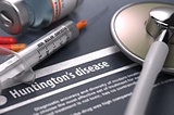 Huntington's disease - Printed Diagnosis on Grey Background.