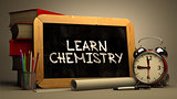 Learn Chemistry Handwritten on Chalkboard.