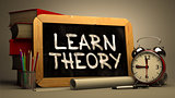 Learn TheoryHandwritten by white Chalk on a Blackboard.