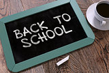 Back to School Handwritten by White Chalk on a Blackboard.