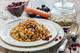 Pilaf with raisins, carrots and cranberries.