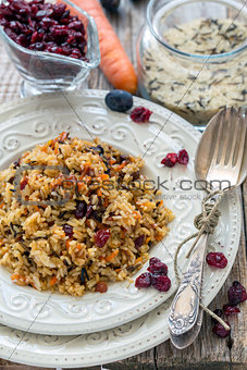 Rice with carrots, raisins and cranberries.