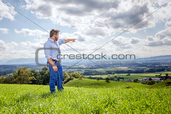 man outdoors pointing