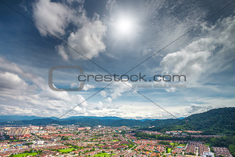 cityscape and mountains against blue sky